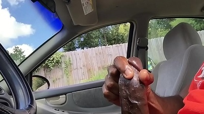 Big black cock cums in public.