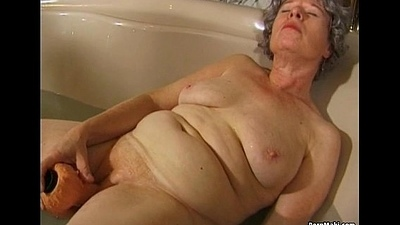 Granny wanks with a marital-device beside bath